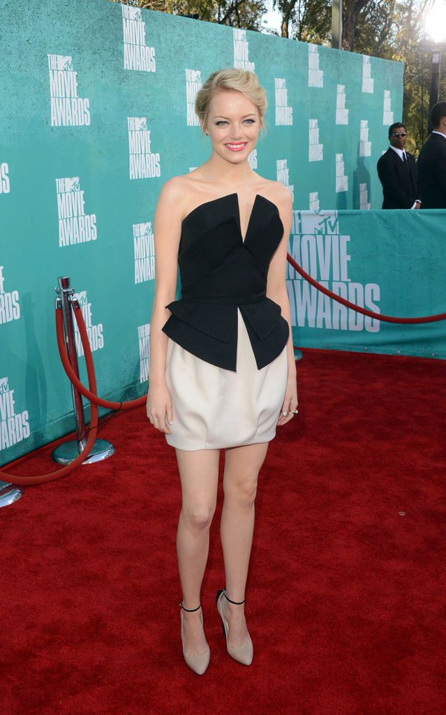 Emma Stone wore short dress for the MTV Movie Awards.