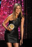 Jennifer Aniston rocked a black leather dress as she accepted her award.