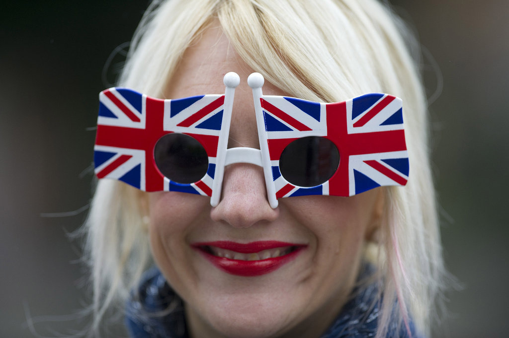 A lady wore flag sunglasses.