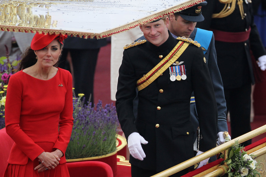 Kate and Prince Harry looked up from the royal barge.