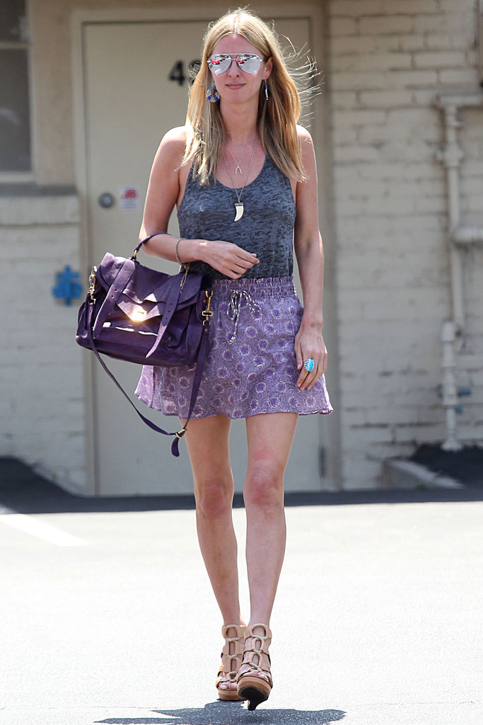 Nicky Hilton made Summer chic look super easy with a few standout pieces — her printed skirt and lace-up wedges updated a staple tank.