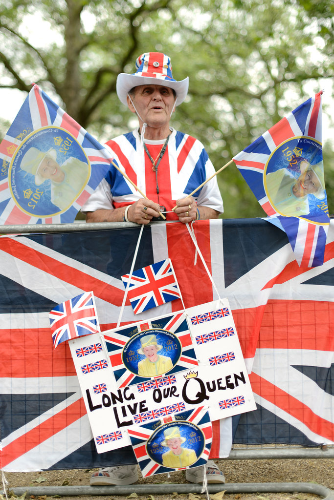A fan of the British royal family waved his Union Jack flags.