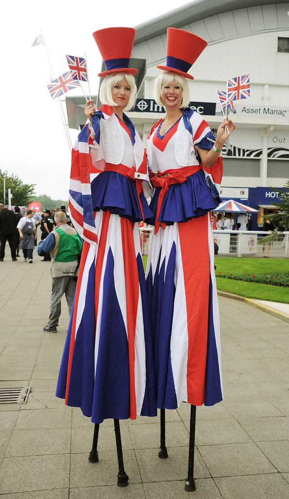Women on stilts dressed festively for the day.