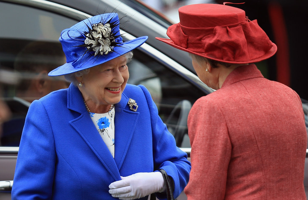 The queen was greeted upon arrival at the Diamond Jubilee Derby.