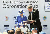 Queen Elizabeth and Anthony Cane, chairman of Epsom Downs Racecourse, presented the Diamond Jubilee Coronation Cup.