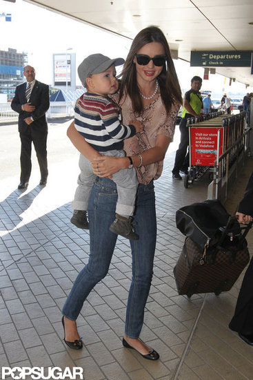 Miranda Kerr carried son, Flynn Bloom, at the Sydney airport.