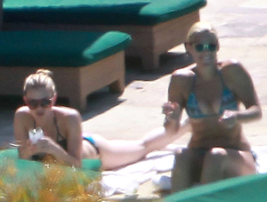 Scarlett Johansson and Busy Philipps lounged by the pool before attending Drew Barrymore's wedding.