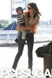 Miranda Kerr carried son, Flynn Bloom, as they left Sydney.