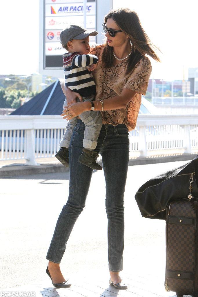 Miranda Kerr carried son, Flynn Bloom, as they left Sydney.