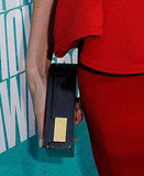 Charlize Theron complemented her sophisticated peplum-trimmed Lanvin with a sleek clutch also from the label.