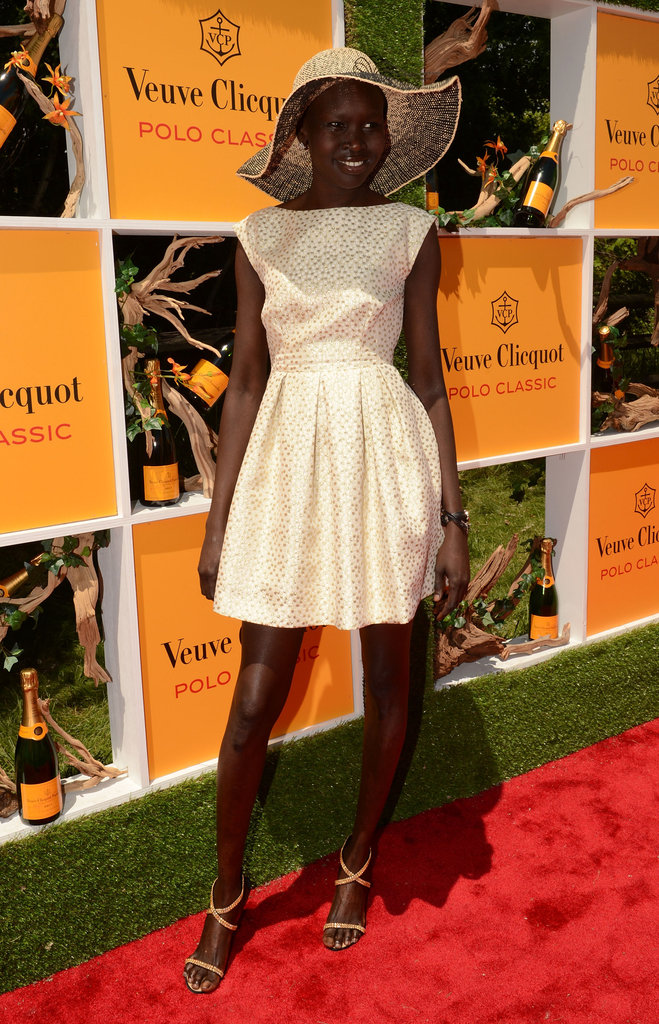 Alek Wek channeled a classic polo look in an LWD and festive Derby-inspired hat.