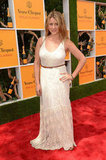 Lo Bosworth belted her long white maxi dress to give the billowy silhouette more shape.
