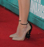Emma Stone added a playful finish via embellished black and nude Brian Atwood pumps.
