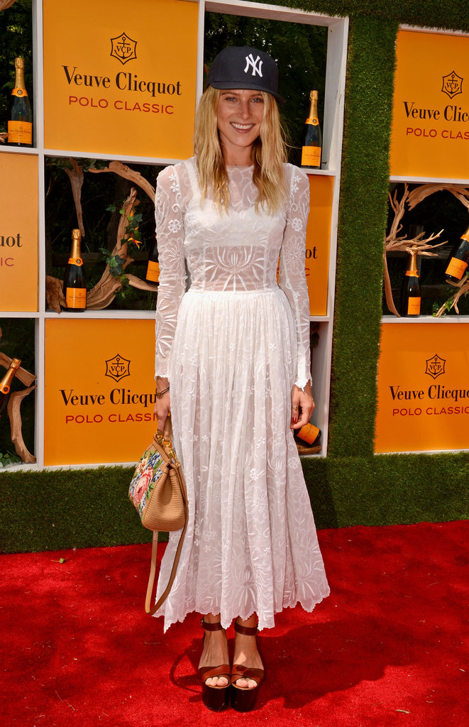 Dree Hemingway gave her sheer white Dolce & Gabbana dress a casual feel via a New York Yankees baseball cap and cool wedge platforms.