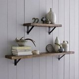 Adding a Salvaged Wood Shelf ($59-$99) helps Dad organize anything from books to trophies in style.