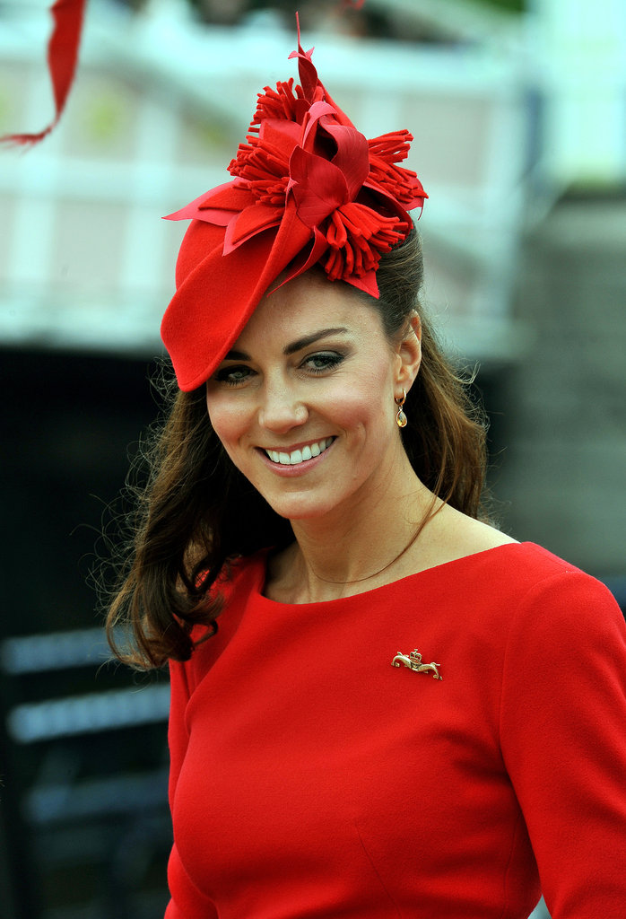 Kate accessorised with a maritime-themed brooch featuring two silver dolphins — a gift from the Royal Navy Submarine Service.