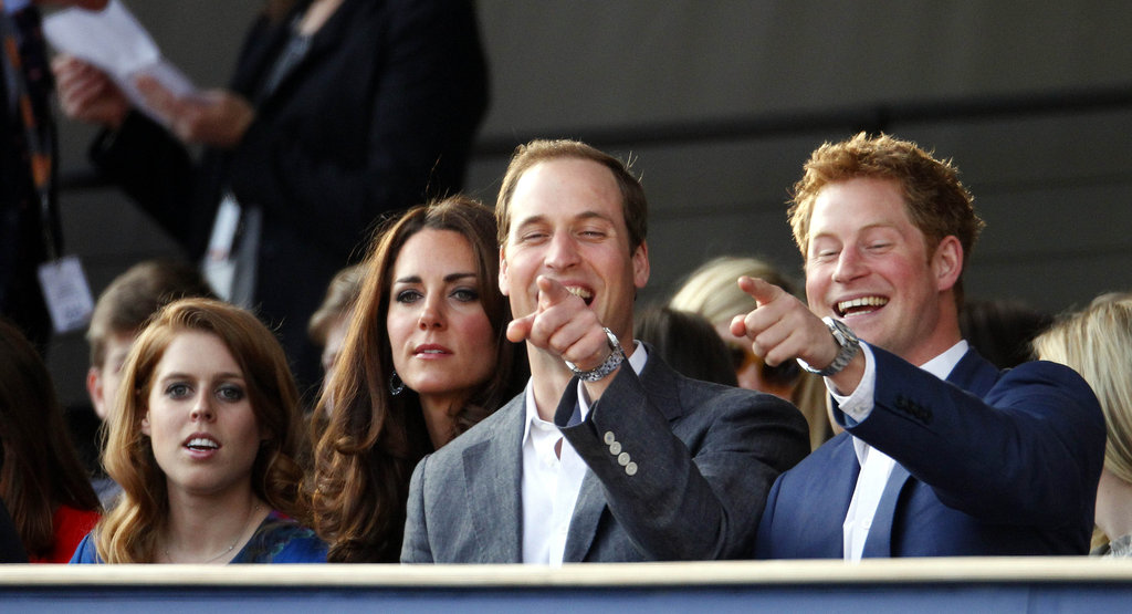Prince William and Prince Harry pointed together beside Princess Beatrice and Kate Middleton at the Diamond Jubilee Concert at Buckingham Palace.