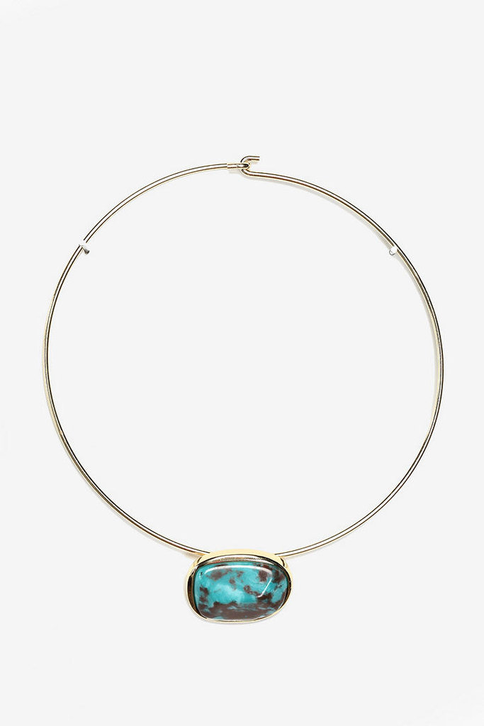 Dress up an LBD ensemble with a pop of turquoise. It will not only draw attention to your décolletage, but it will also accentuate a tan complexion. Urban Outfitters Rock Collector Collar Necklace ($28)