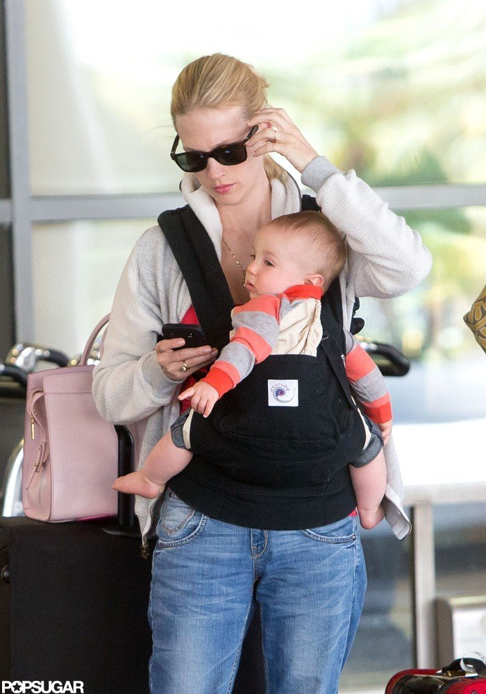 January Jones checked her phone while waiting for a ride from LAX.