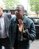Jay-Z waved as he and Beyoncé walked into Caviar Kaspia restaurant in Paris.
