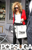 Beyonce carried a shopping bag out of the restaurant.