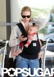 January Jones looked casual in jeans and a zip-up while at LAX with Xander.
