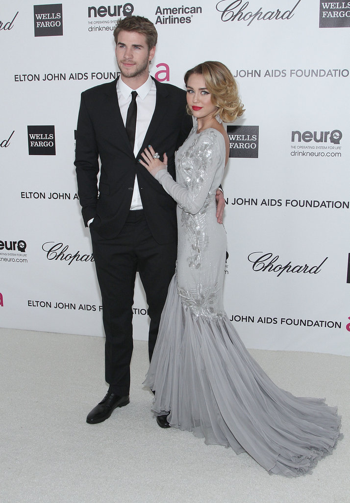 Miley Cyrus and Liam Hemsworth cuddled up at an Academy Awards party in February 2012.