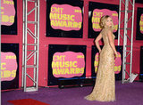 Kristen Bell wore a gold Reem Acra gown to the CMT Music Awards.