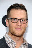 Tom Brady wore his glasses to the opening of Ugg For Men in NYC.