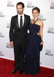 Natalie Portman wore a Dior gown and smiled for pictures alongside husband Benjamin Millepied at a New York City gala in May 2012.