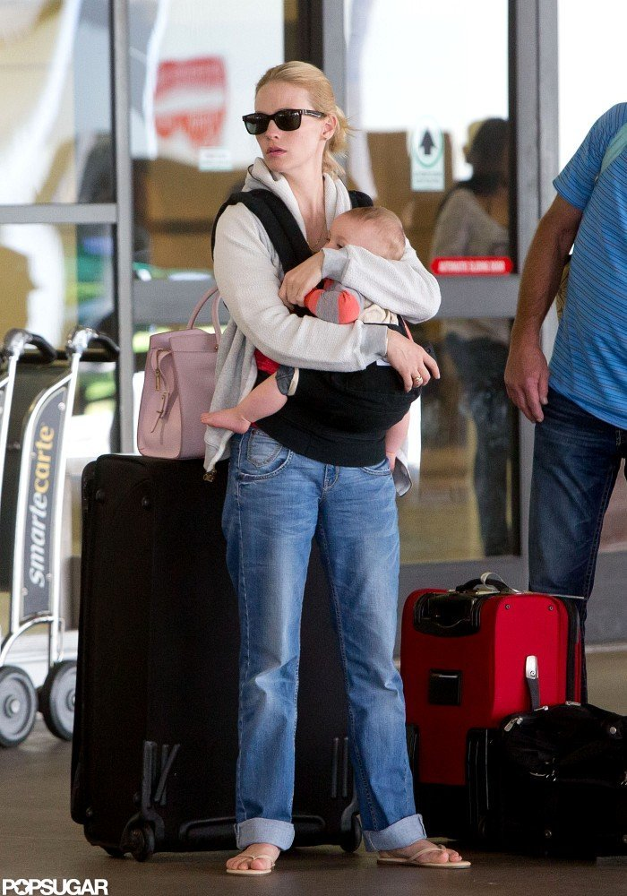 January Jones held tight to son, Xander, after arriving at LAX.