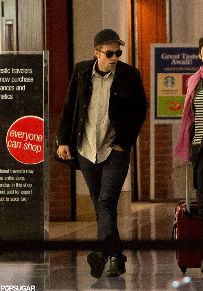 Robert Pattinson landed at LAX after a press tour for his new movie, Cosmopolis.
