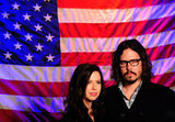 The duo posed in front of an American flag backdrop at their concert in January.
