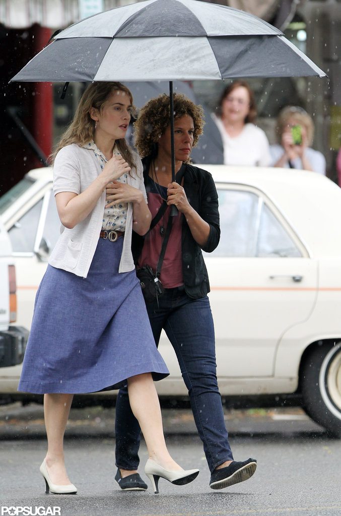 Kate Winslet walked under an umbrella on the set of Labor Day.
