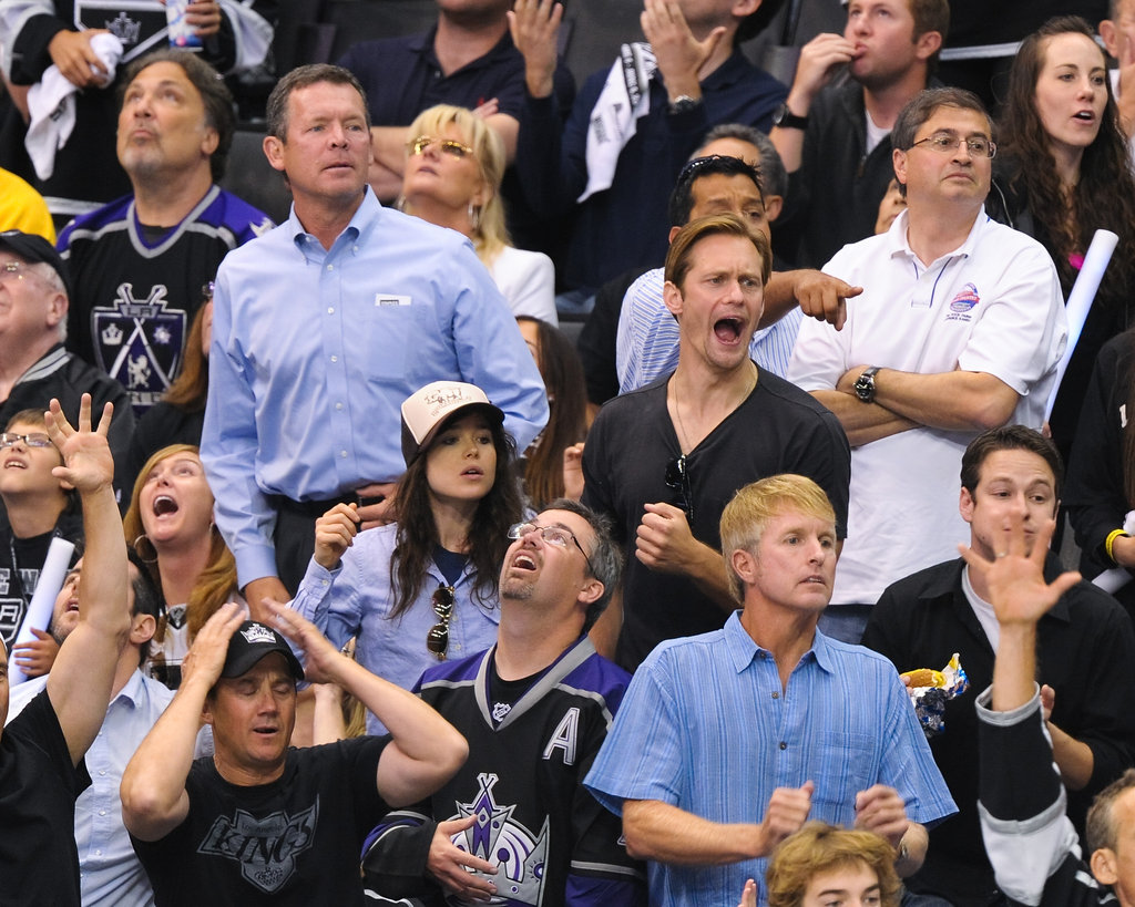 Alexander Skarsgard and Ellen Page cheered at the LA Kings Stanley Cup finals game in LA.