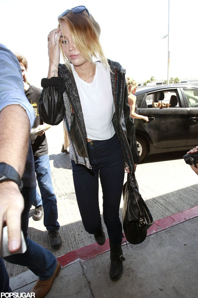 Miley Cyrus traveled through LAX wearing her engagement ring.