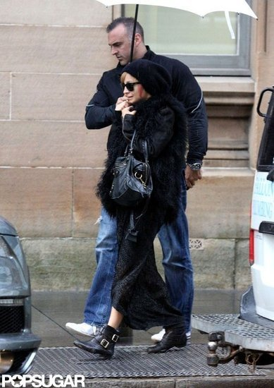Nicole Richie hid under a white umbrella from the rain in Australia.