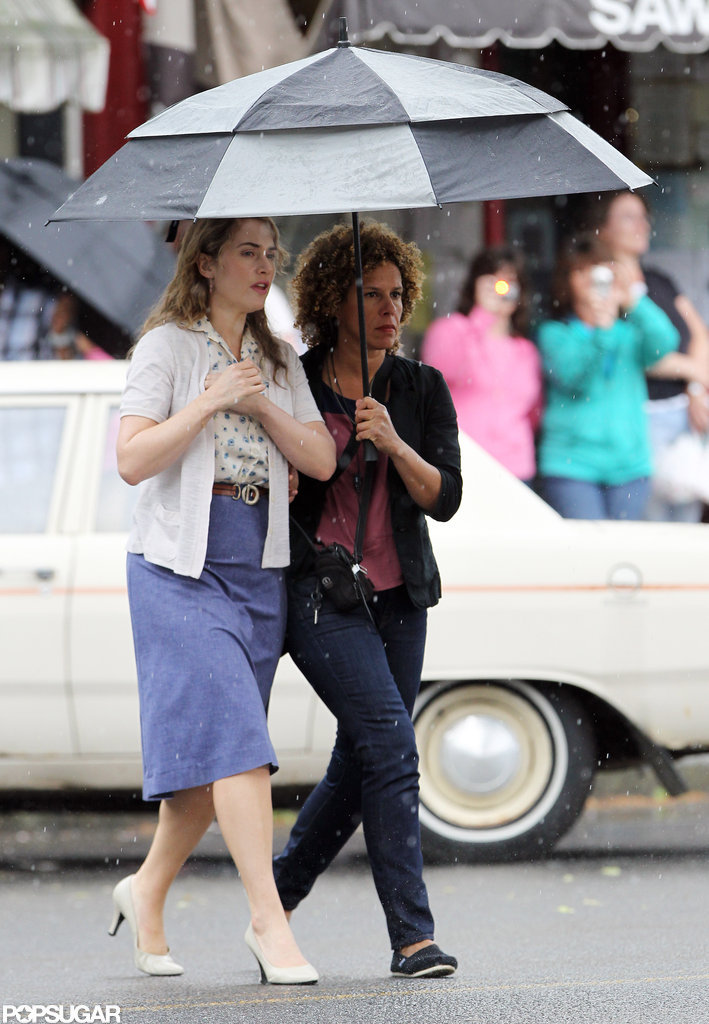 Kate Winslet hid from the rain under an umbrella on the set of Labor Day.