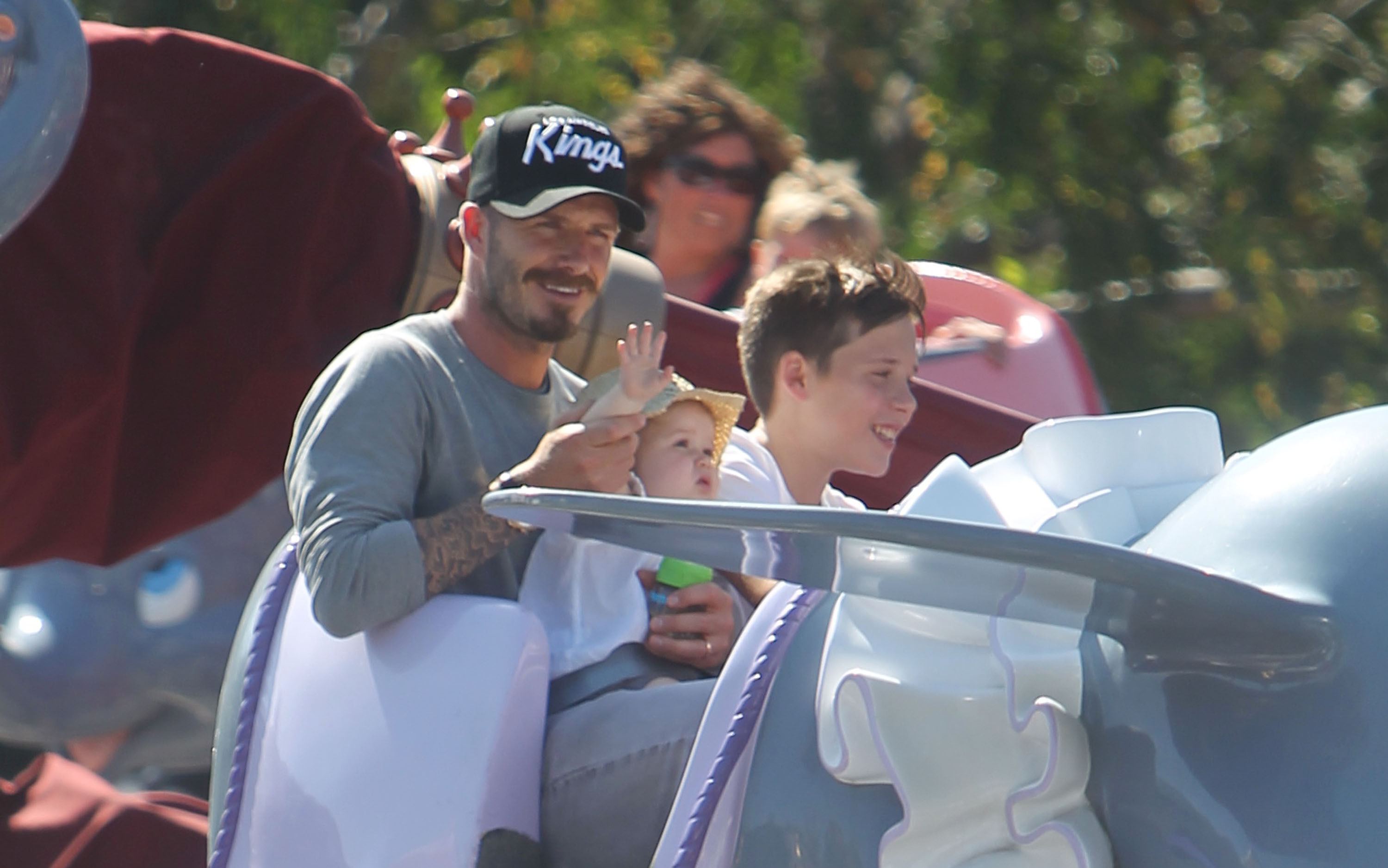 David Beckham rode on a ride at Disneyland in June 2012 with Harper and Brooklyn.
