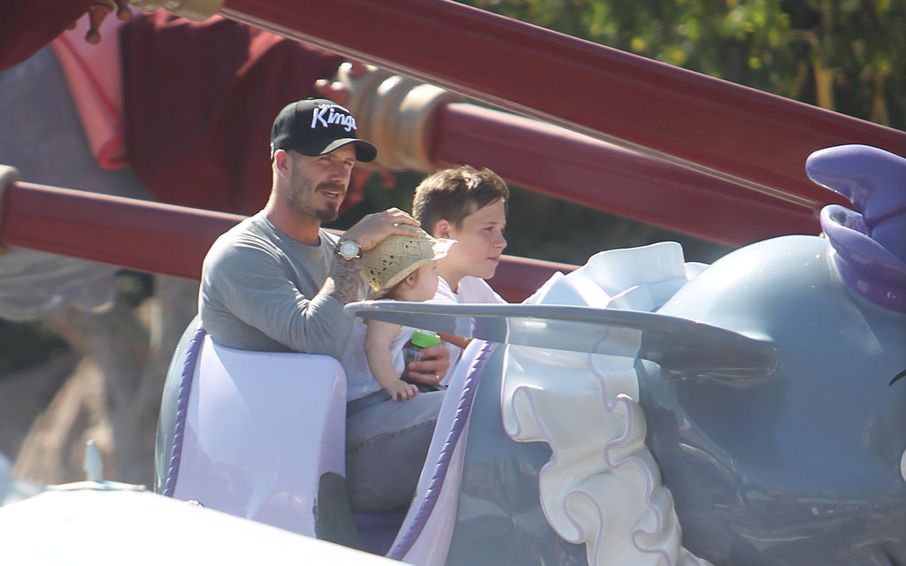 David Beckham held Harper on a ride at Disneyland.