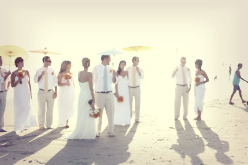 This wedding party kept cool with pretty parasols. Source