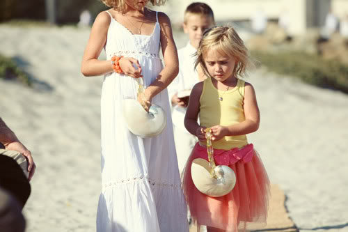 Instead of traditional baskets, these flower girls carried gorgeous seashells.  Source