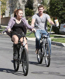 Miley Cyrus and Liam Hemsworth took a bike ride through Toluca Lake in California in March 2010.