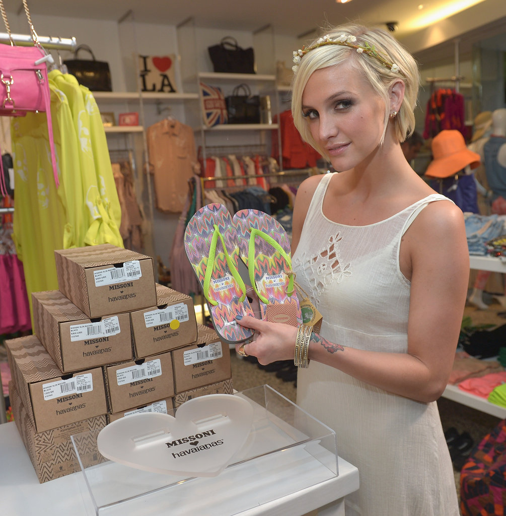 Ashlee Simpson held up a pair of the new flip-flops.