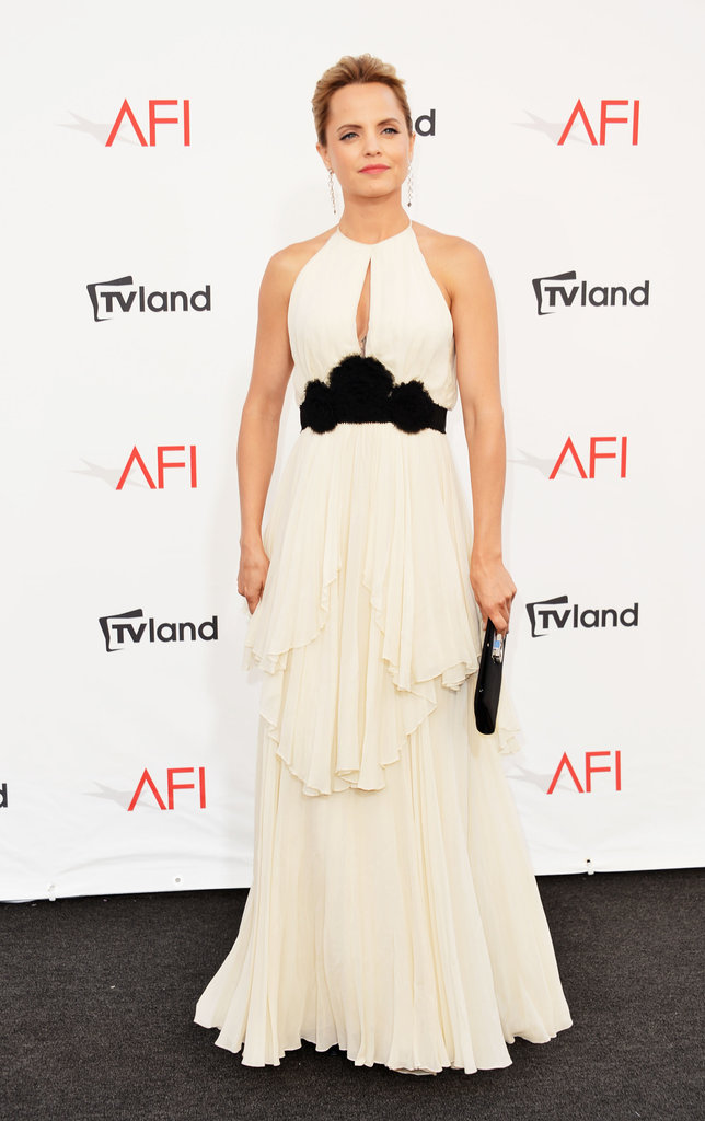 Mena Suvari wore a black and white gown to the AFI Life Achievement Award dinner honoring Shirley MacLaine in LA.