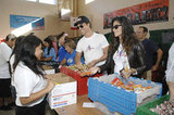 Matthew McConaughey and Camila Alves smiled while doing charity work at the Operation Gratitude Event in LA in October 2009.