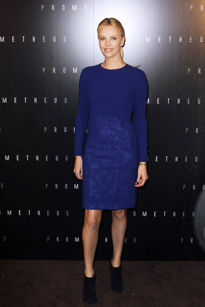 Charlize Theron kept it sleek in a blue sheath and booties while promoting Prometheus.