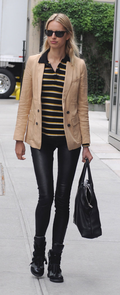 Karolina Kurkova put a cool-girl spin on stripes with leather leggings and high-tops.