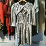 We spied a metallic minidress (and coordinating cape!) perfect for the holidays at Tracy Reese.