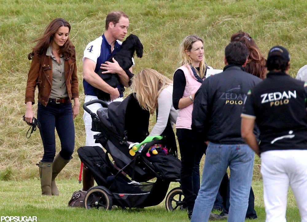 Kate Middleton walked beside Prince William as he carried their dog, Lupo, at an English polo match in July.